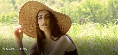 Woman in Sunhat in Field - 3