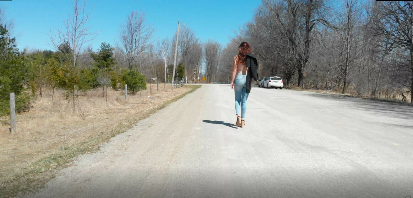 Woman Walking on Country Road 1