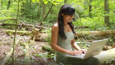 Young Woman Typing in the Forest -G 3