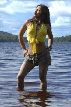 Woman standing in sunny lake 155