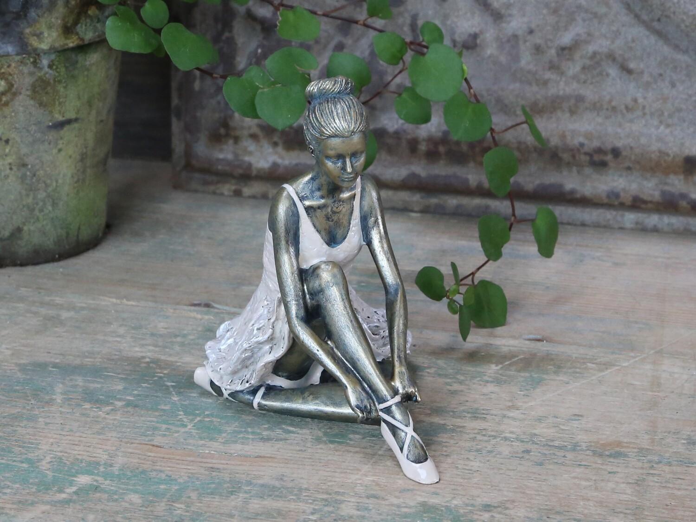 Ballerina zittend