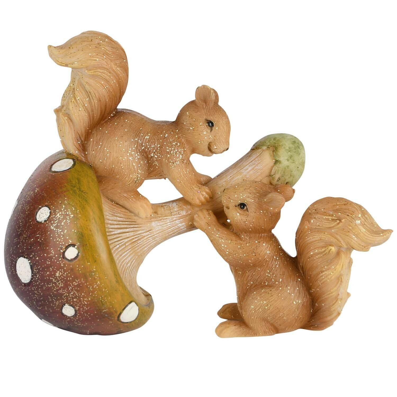 Koppel eekhoorns op paddenstoel