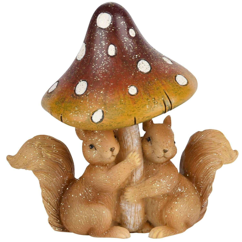 Koppel eekhoorns onder paddenstoel