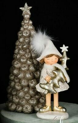 Meisje staand met kerstboom
