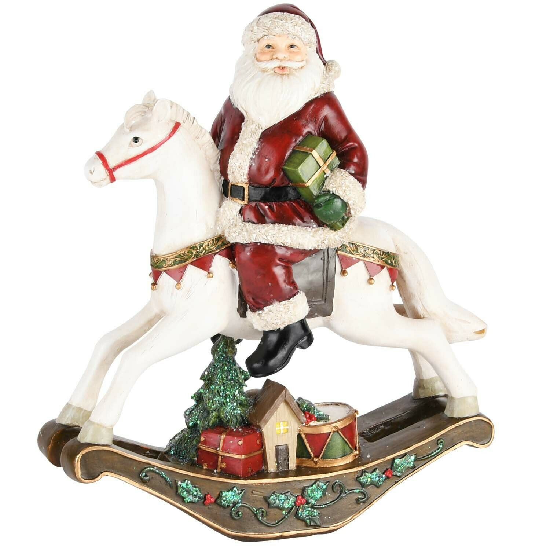 Santa op schommelpaard