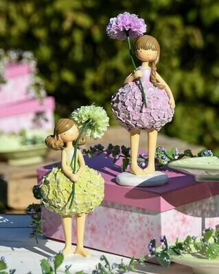 Set 2 meisjes staand met bloem