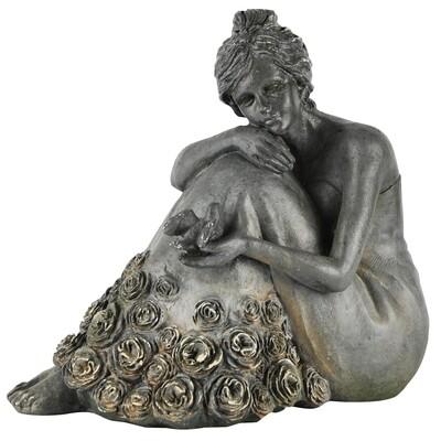 Deco dame met bloemenjurk zittend grijs
