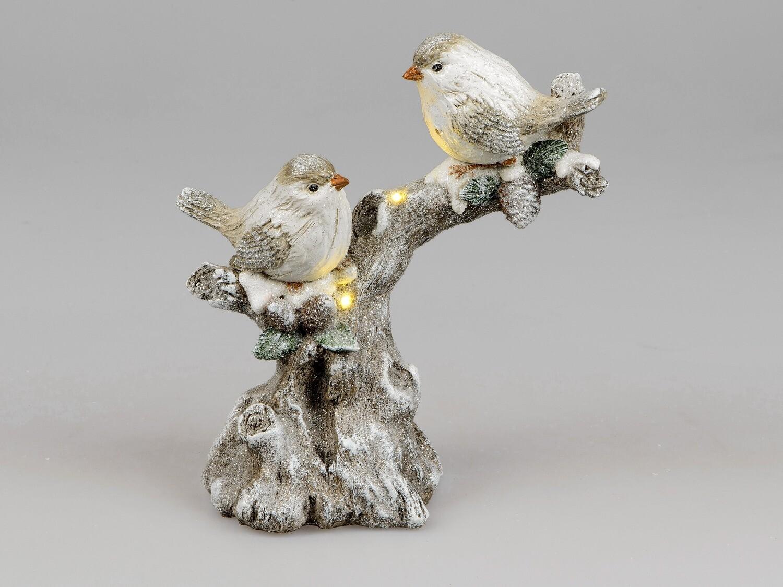 Vogeltjes op tak met LED-licht
