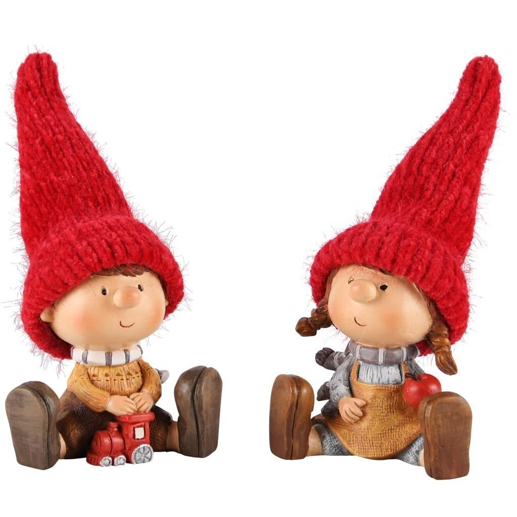 Set Kindjes met rode muts zittend