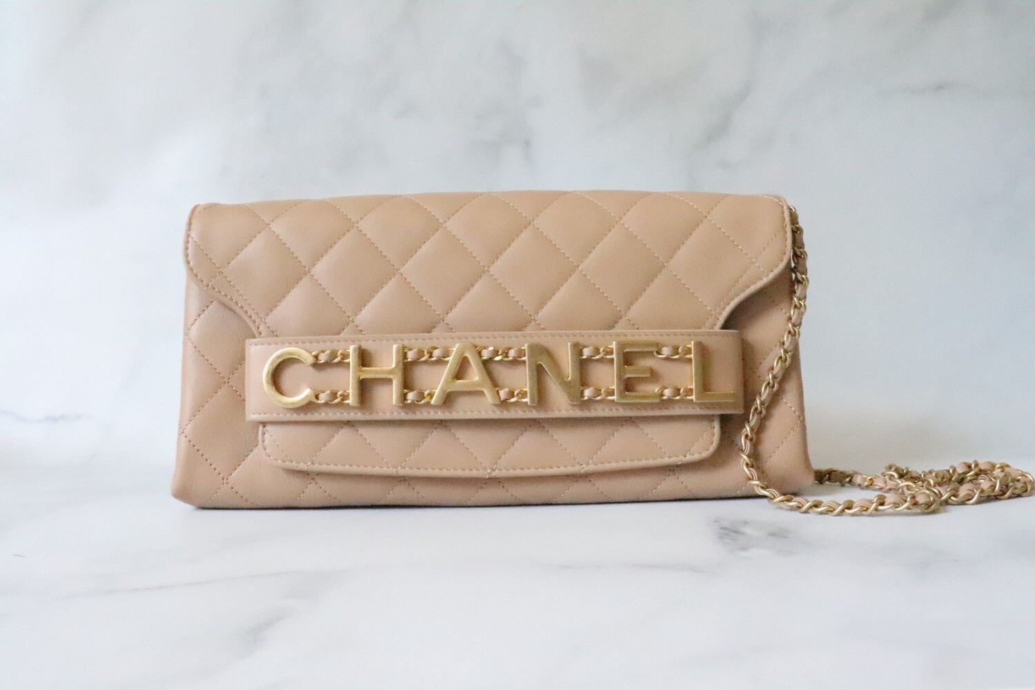 Chanel Seasonal Beige Enchained Logo Clutch Bag, Gold Hardware, Pre-owned in Dustbag