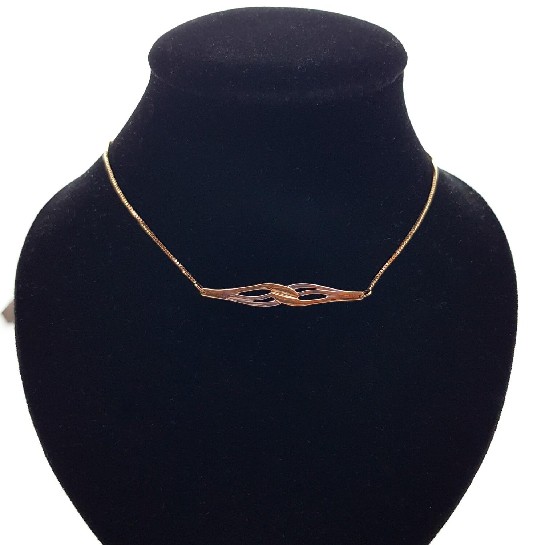 Transformation d'une bague en or 18 ct en collier