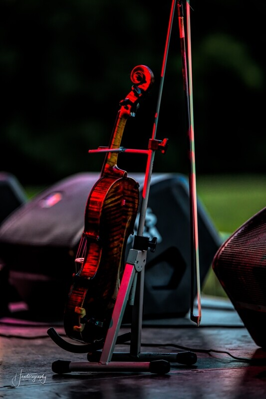 Violin Lit By Red Stage Lighting 258A