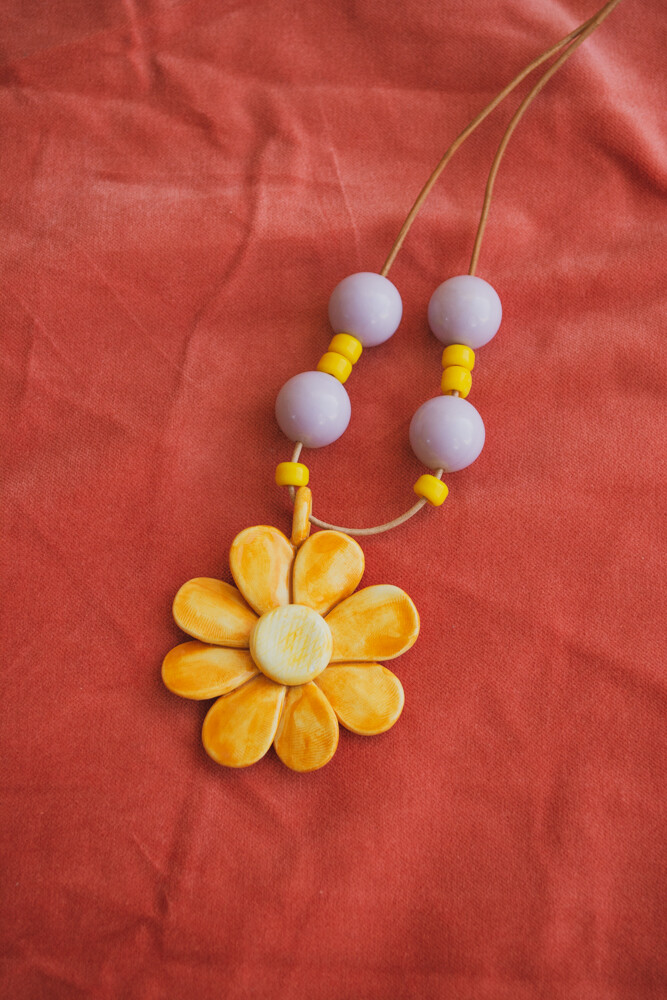 Yellow clay flower necklace