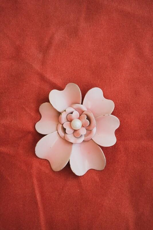 Pink metal retro brooch
