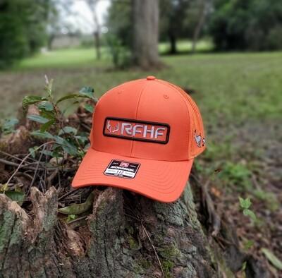 Solid orange dog hunter /black and grey logo