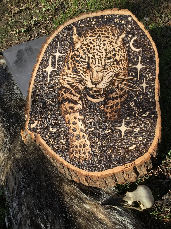Jaguar wood burnt art