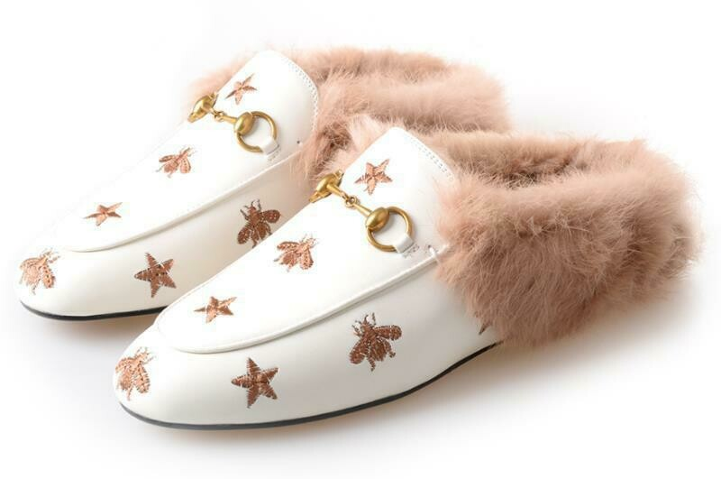 white leather slide mules with natural fur lining