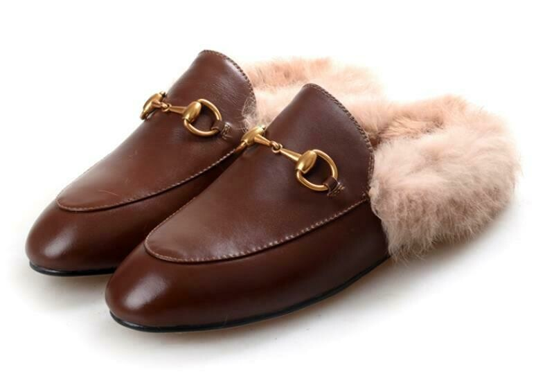 Brown leather slide mules with natural fur lining