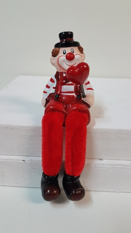 Clown mit Herz in linker Hand