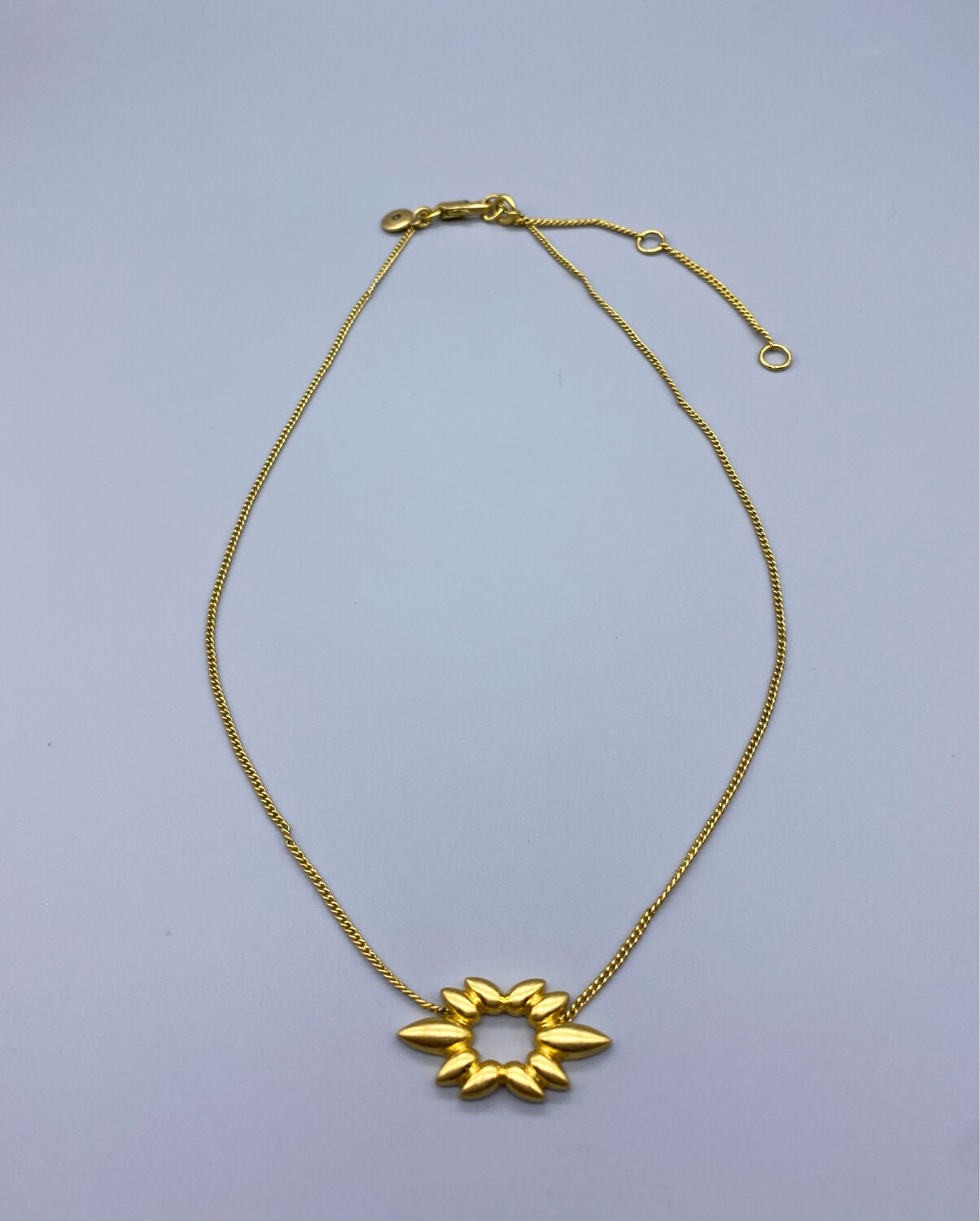 Gold Necklace With Geometric Charm