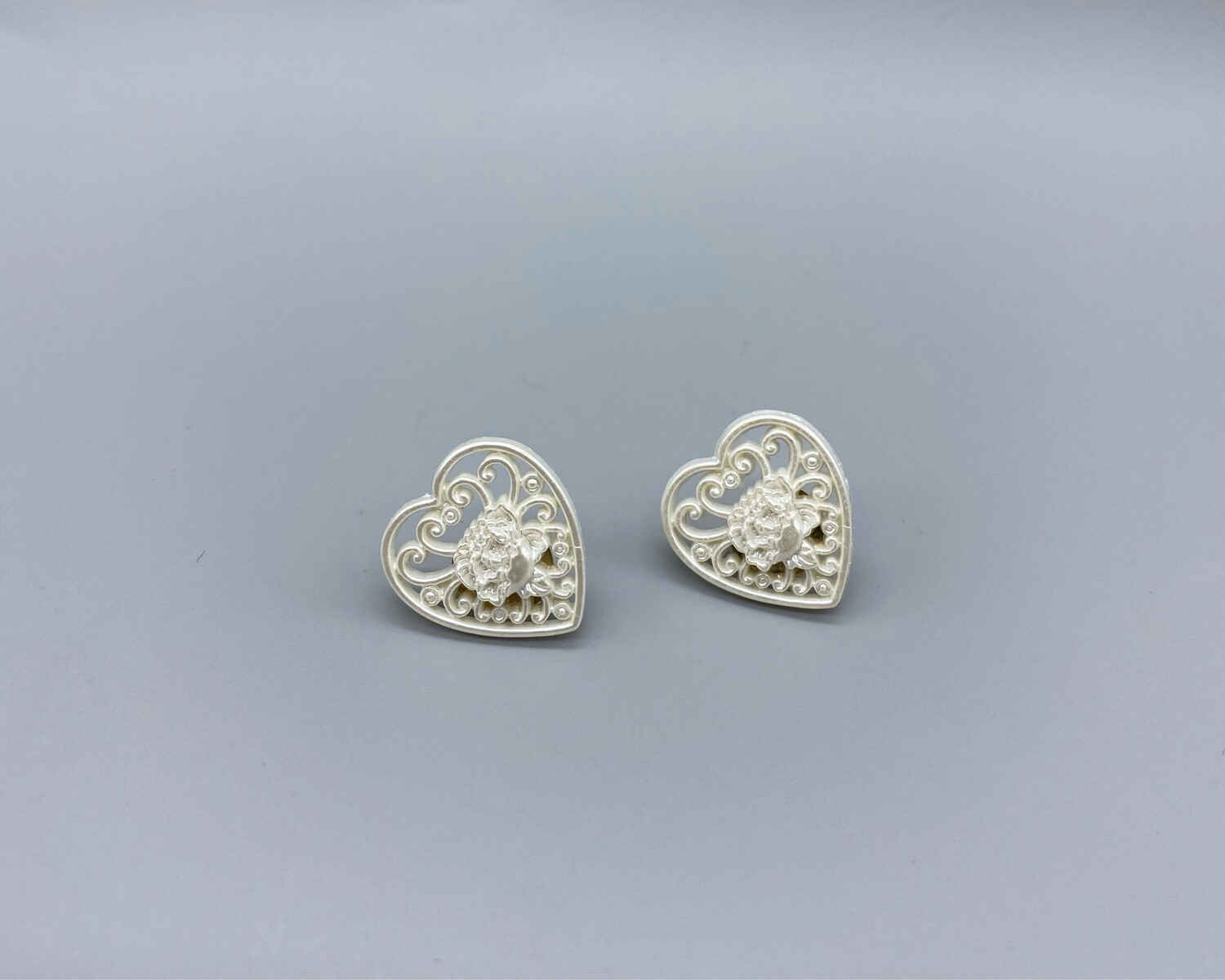 White Carved Heart Studs