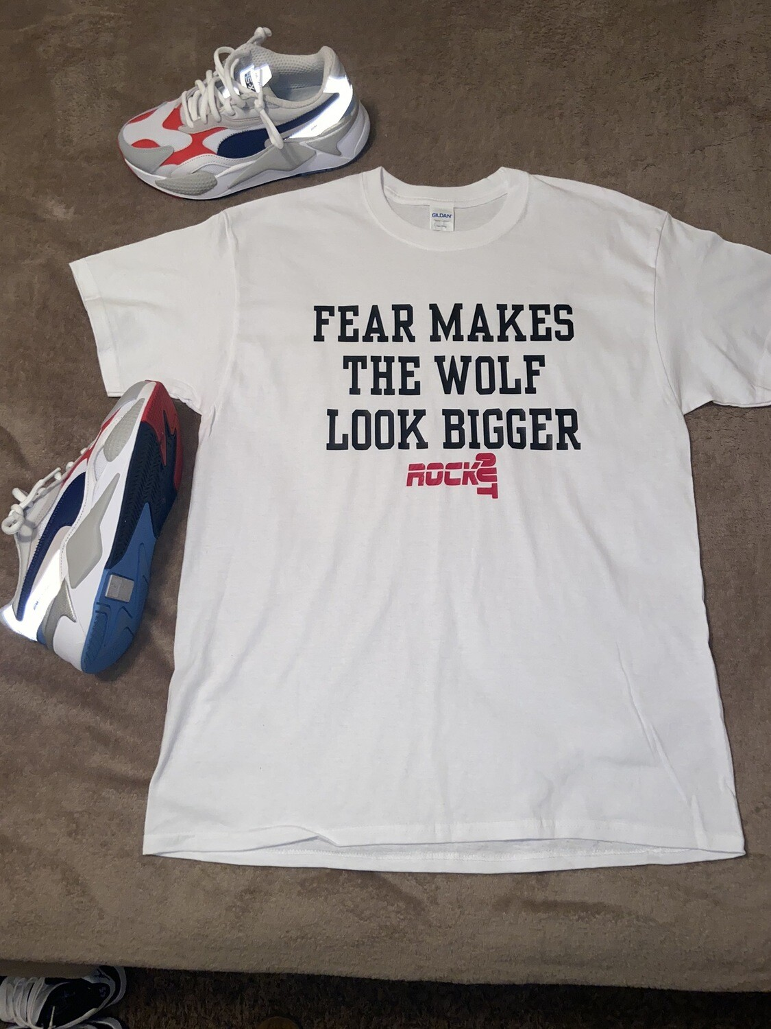 """ Fear Makes The Wolf Look Bigger "" T Shirt"