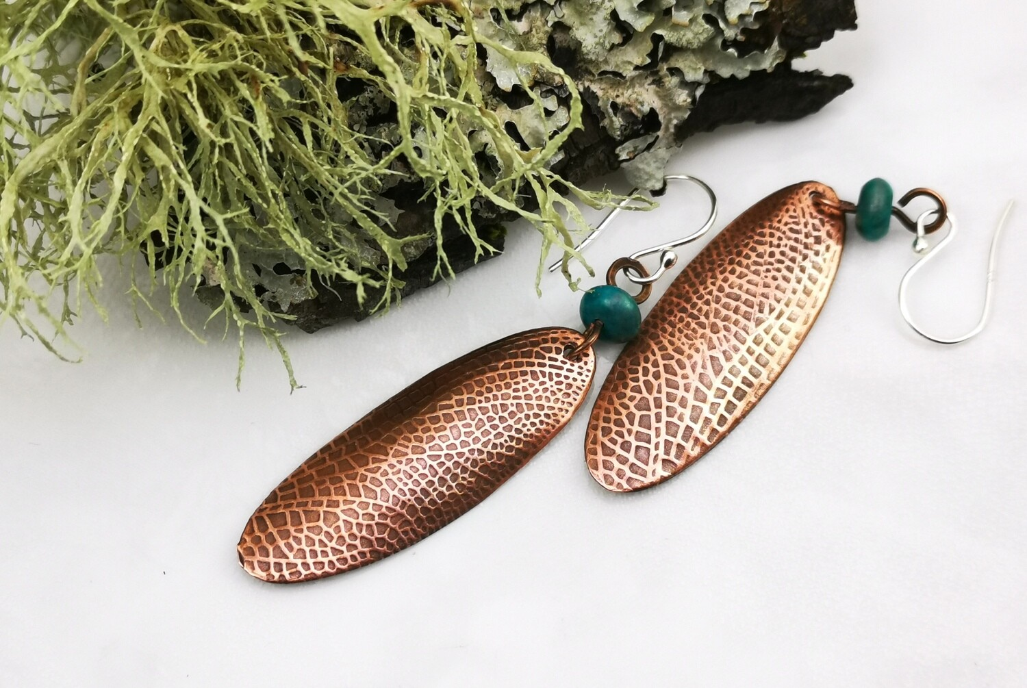 Skinny Oval Fairy / Dragonfly Wing Textured Copper Earrings with a blue green bead
