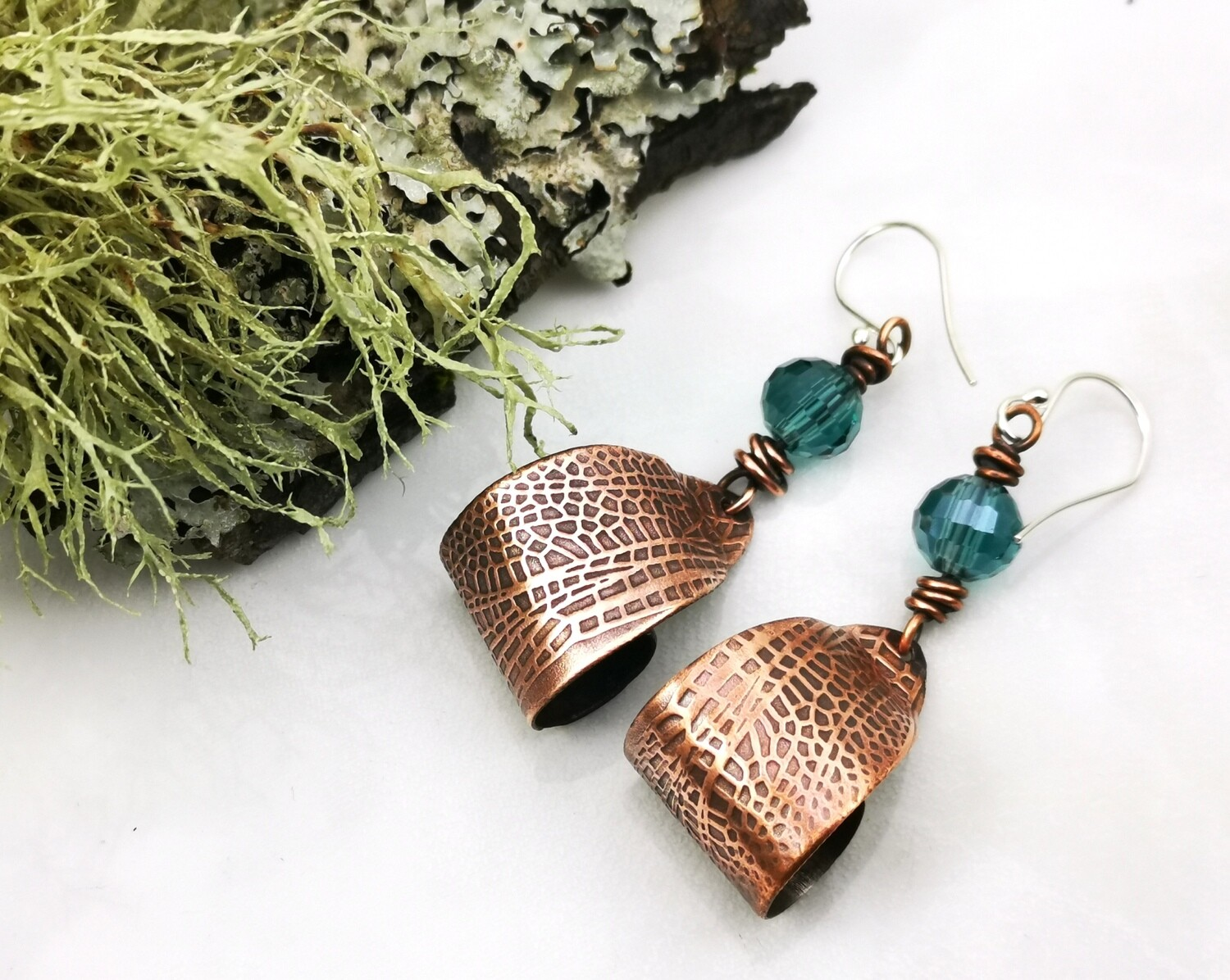 Curled Fairy / Dragonfly Wing Textured Dangle Copper Earrings with a faceted blue green bead