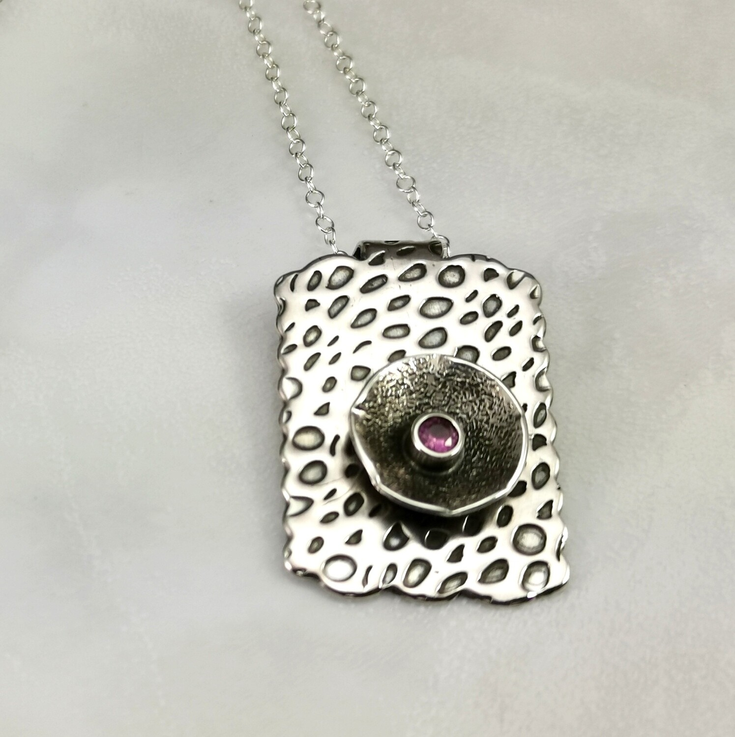 Sterling Silver Pendant with Scalloped Edges and Tube Set Pink Sapphire CZ Faceted Stone