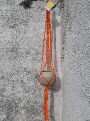 Orange macrame hanger with grey concrete ball pot