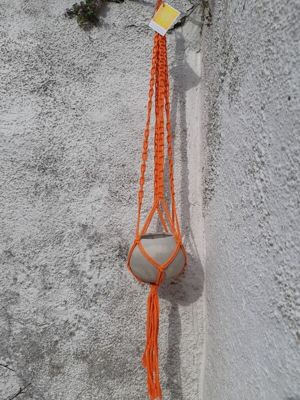 Orange macrame hanger with grey concrete ball pot