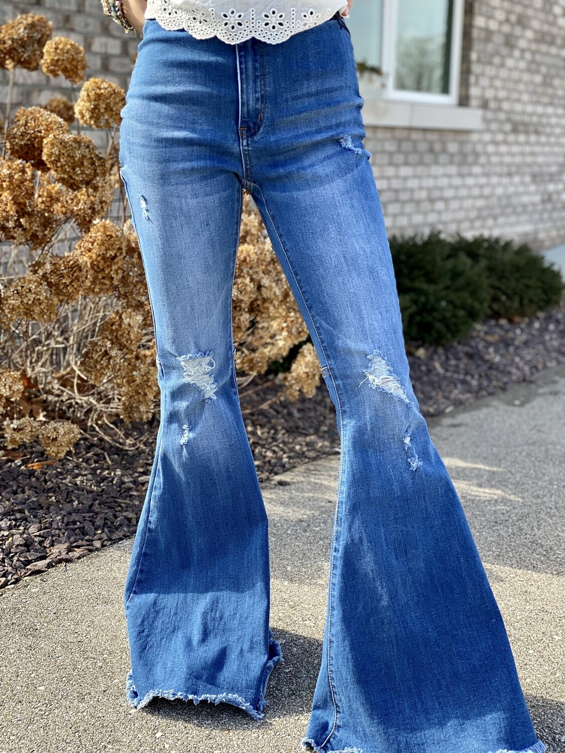 Medium Washed Light Distressed Flares
