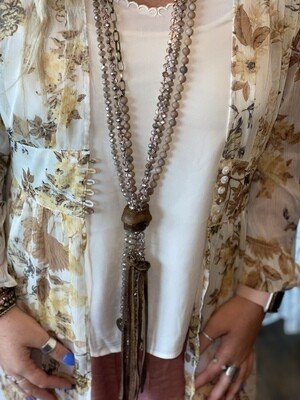 Tan Multi Strand Beaded Leather Tassel Necklace With Charms