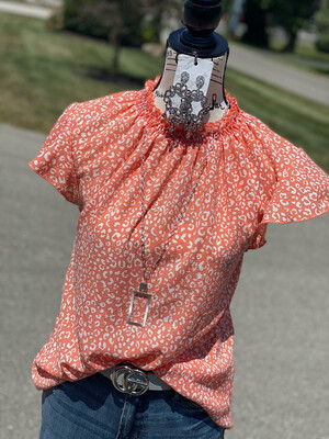 Coral Cheetah Tiered Mock Neck Blouse