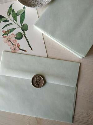 Busta verde chiaro in carta pergamena