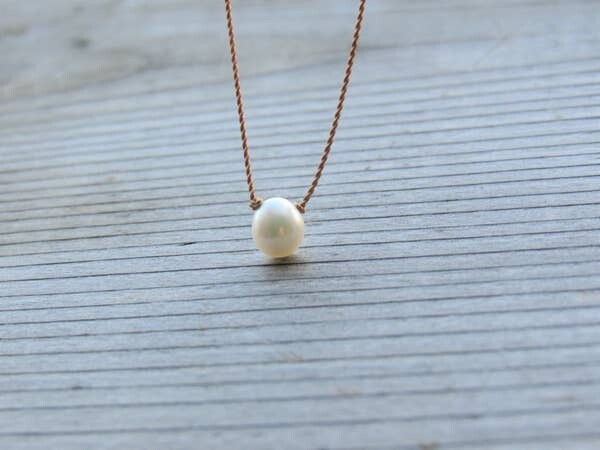 Single Freshwater Pearl on Silk