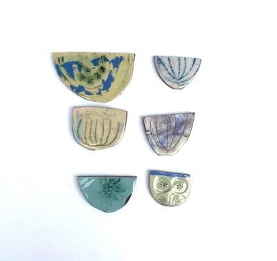 6 sets of coloured semi circles  45/55 x 25/30 x 4mm (varies)