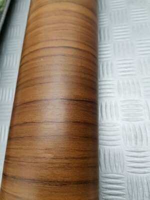 Plastica adesiva colore legnoTeak  2 mt x 67,5 cm