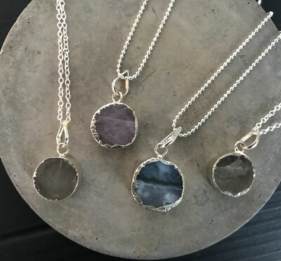 Round Crystal Pendant on Silver Chain