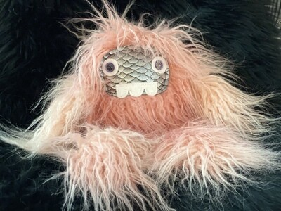 Crystal Infused Protective Snuggle Monster -Pink with silver scale face and three teeth