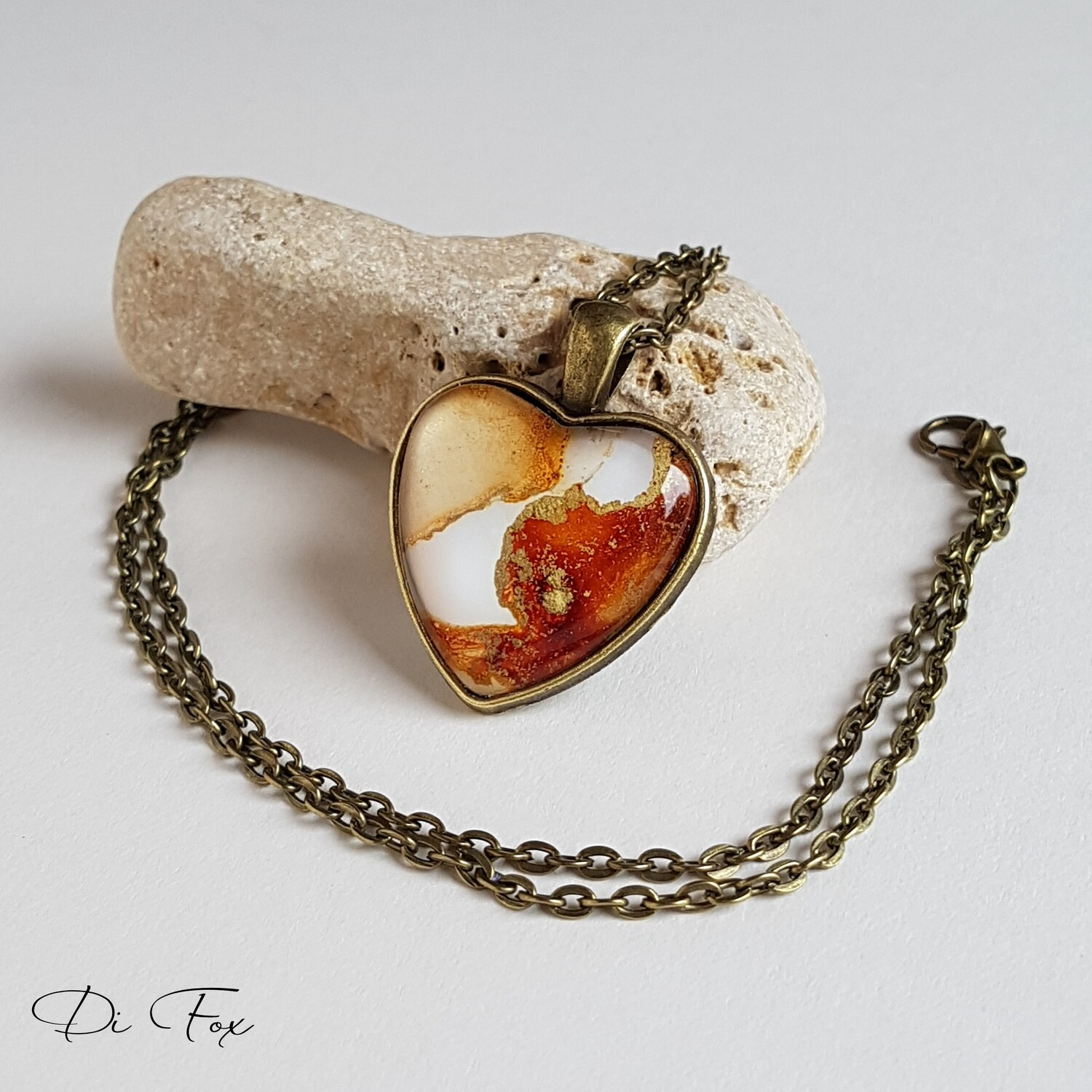 Caramel, Toffee, White and Gold heart shape Bronze pendant and chain.