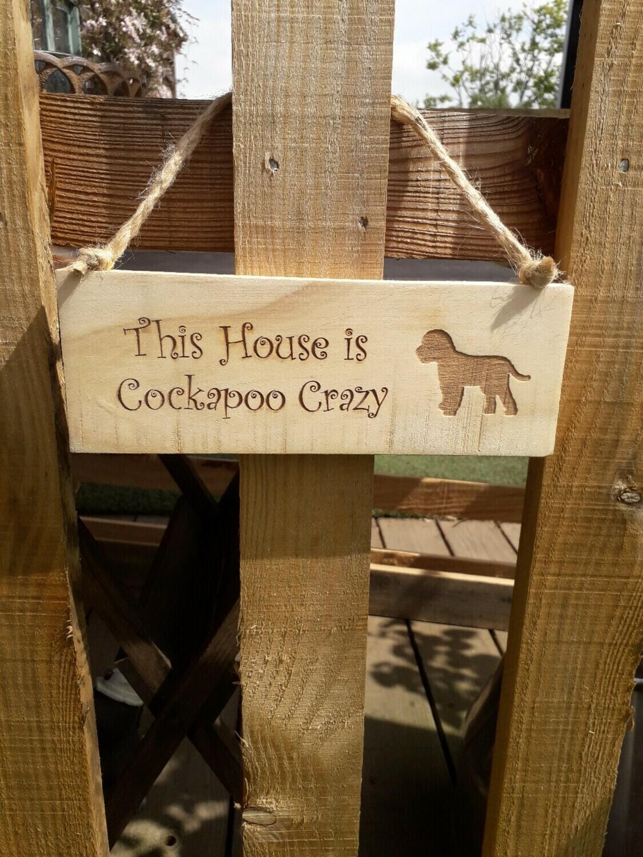 Cock a poo Sign.