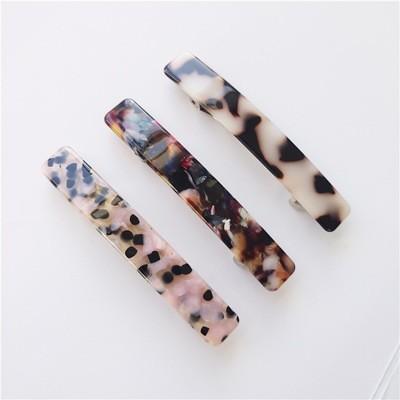 Multi-coloured resin hair barrette