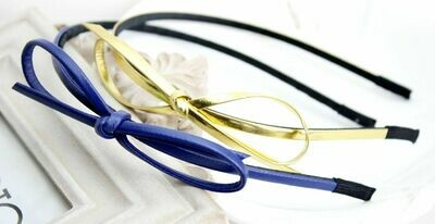 Pretty faux leather bow knot headband