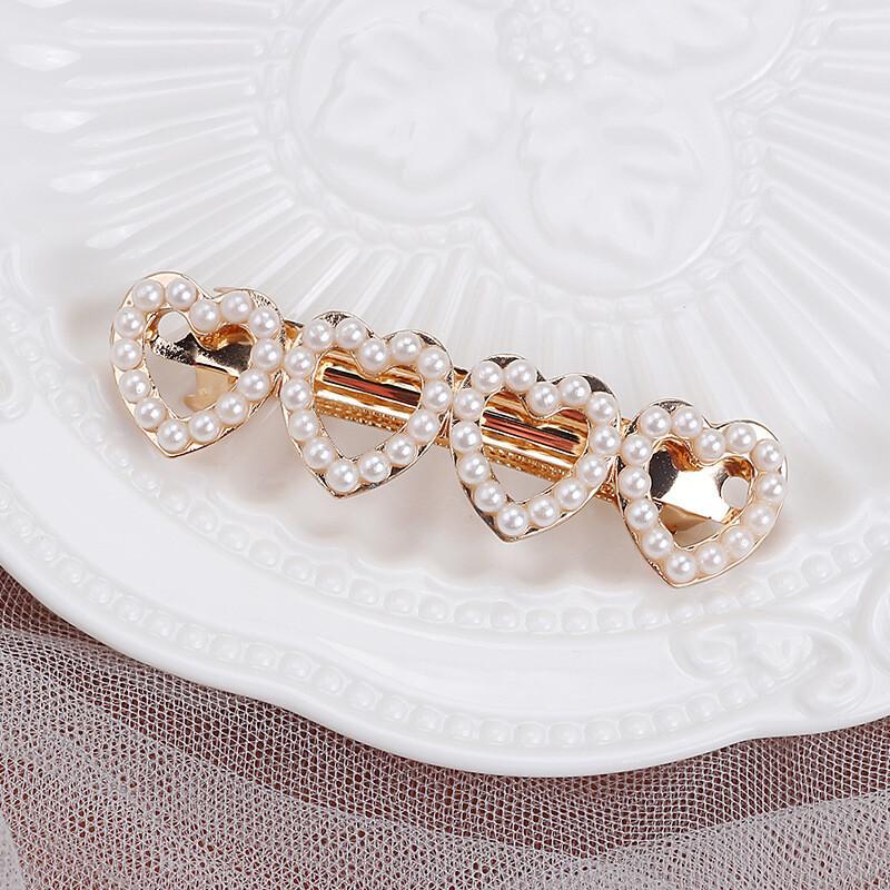 Pearl studded hearts hair barrette