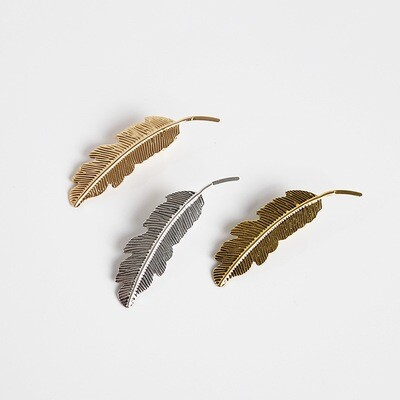 Small metallic feather hair slide