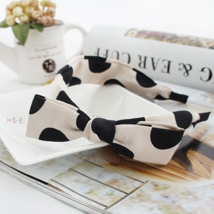 Black polka dots on cream coloured headband with bow