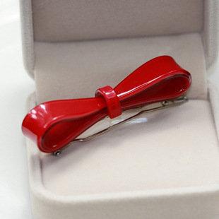 Red acrylic bow hair clip