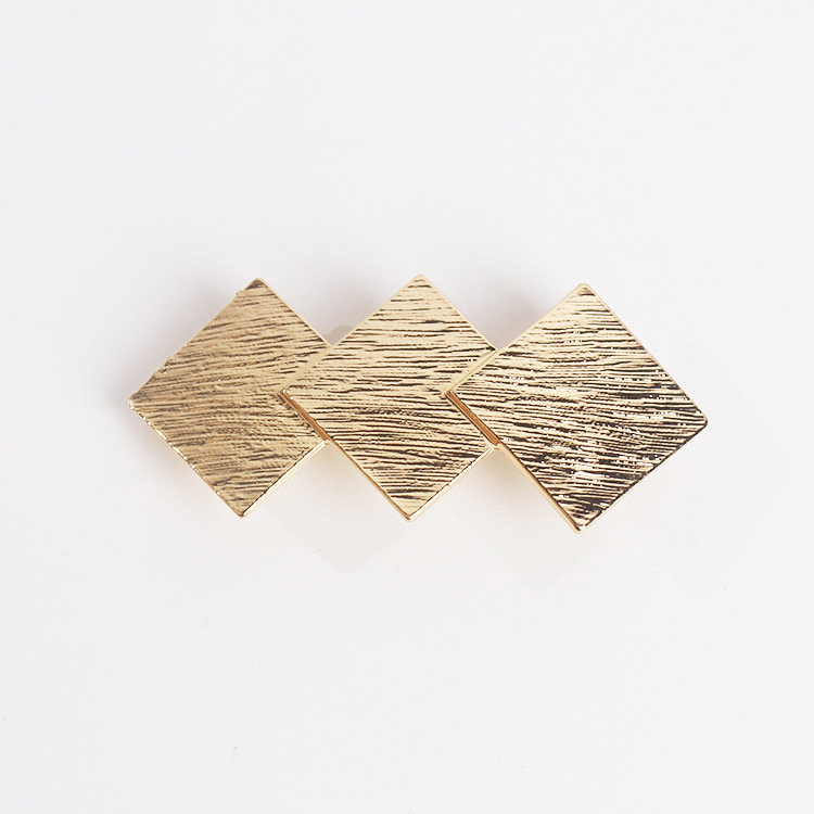 Triple-triangle hair barrette