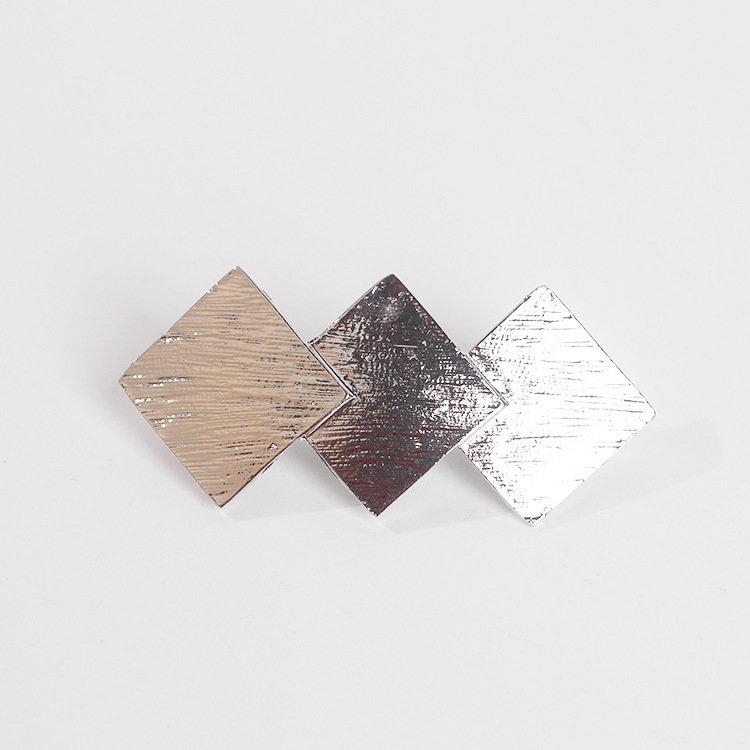 Triple-triangle hair barrette